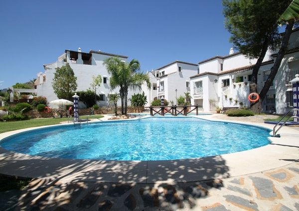 Conveniently located 2 bedroom ground floor apartment offering privacy and direct access to the beau, Spain