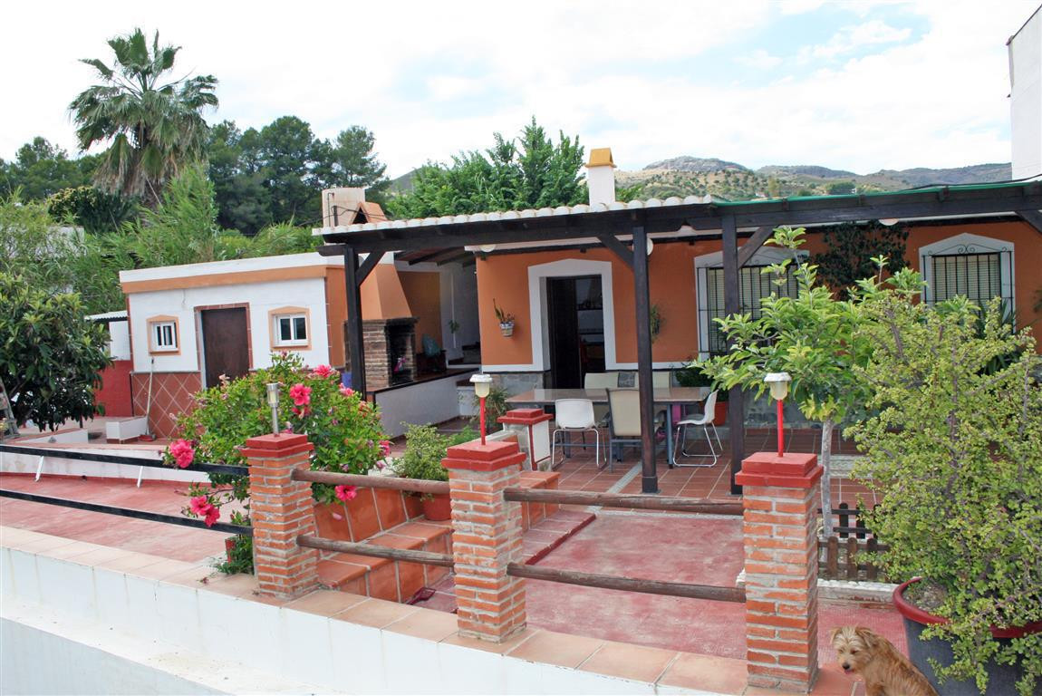 Beautiful semi-detached country house located near the village of Alora. The property has 3 large be, Spain
