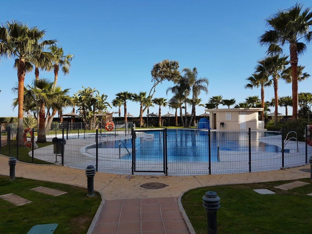 Beachfront Southt facing two bedroom ground floor apartment in Estepona beachside, located just a fi,Spain