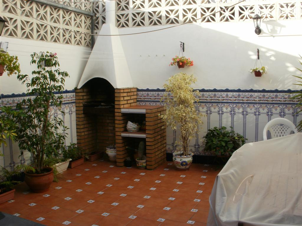 This former house has been split into two apartments, this one being on the lover level.  There is a,Spain