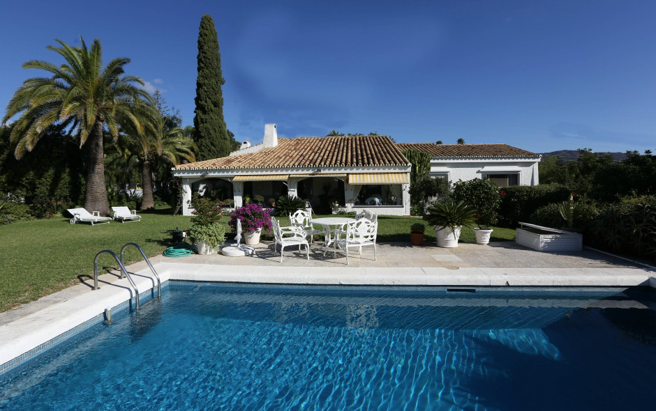 This completely renovated villa is located in a calm and private area within El Rosario. It has a we,Spain