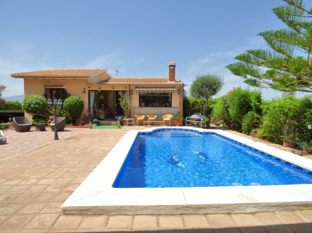 This pretty detatched villa is located on a popular urbanisation in Coin, close to padel tennis, sho,Spain