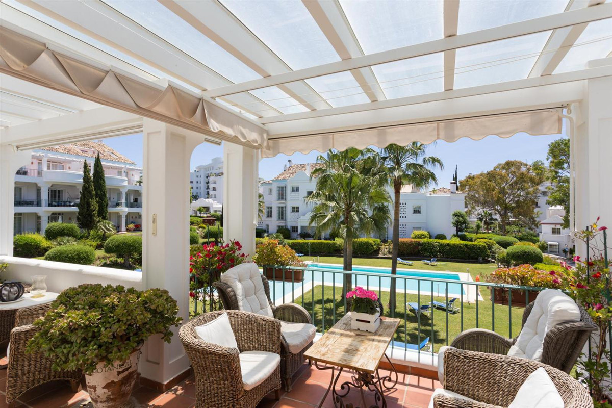 Well-planned penthouse on two floors with several terraces and lovely garden and pool views.  On the,Spain