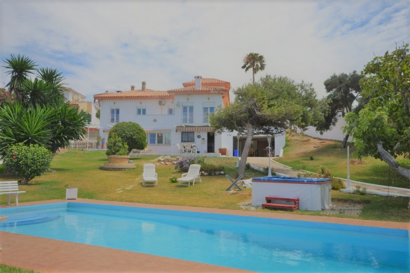 Charming front line 6 bedroom villa for sale in this popular seafront urbanisation situated halfway , Spain
