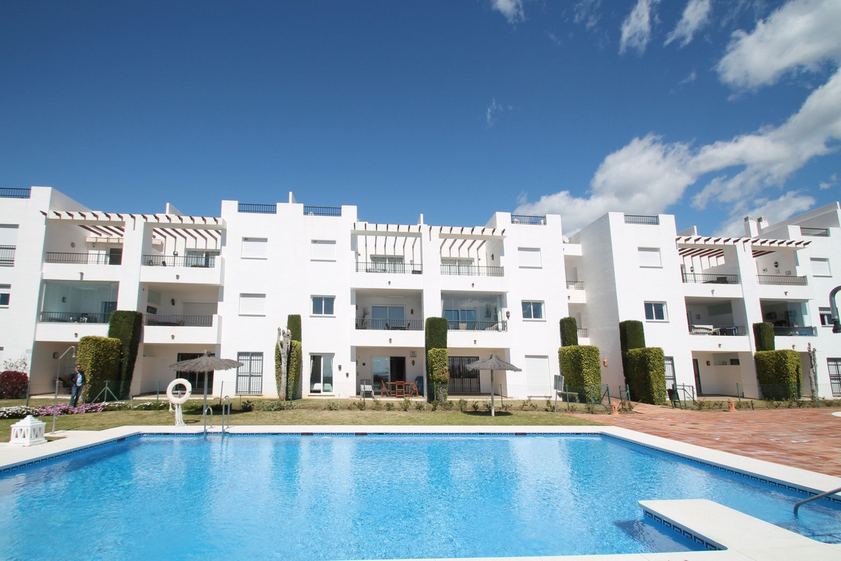 South facing two bedroom garden apartment within a gated complex with gardens and a large swimming p, Spain