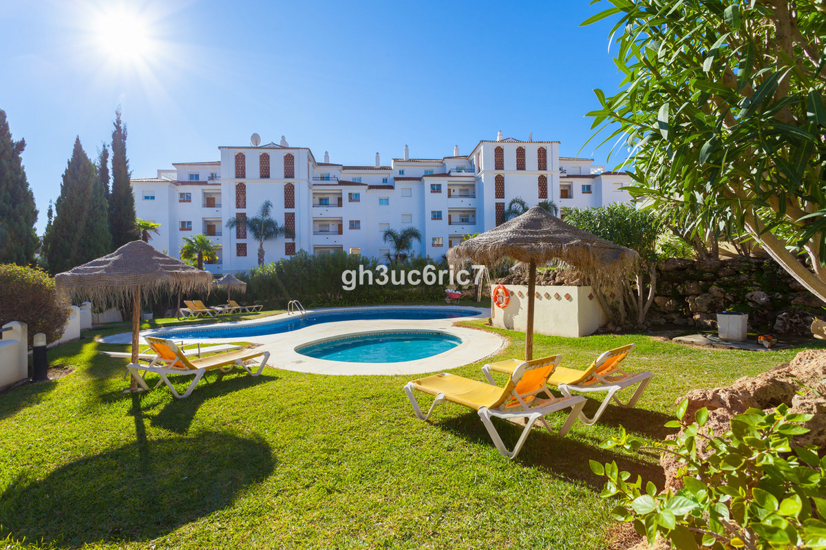 Charming townhouse located in a gated complex that enjoys a communal swimming pool and garden and th,Spain
