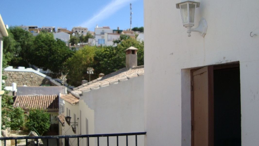 This traditional Spanish house is located in the village of Periana. It comprises lounge (with air c, Spain