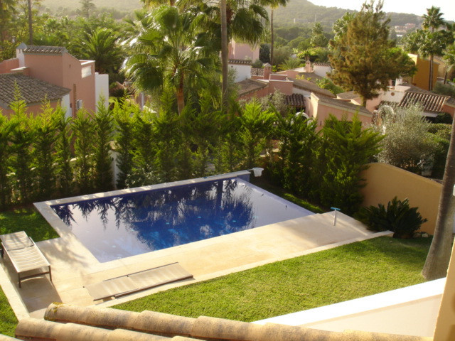 On a plot of 350m2., In the heart of the Golf Santa Ponsa I, this beautiful house, built in 1997, di, Spain