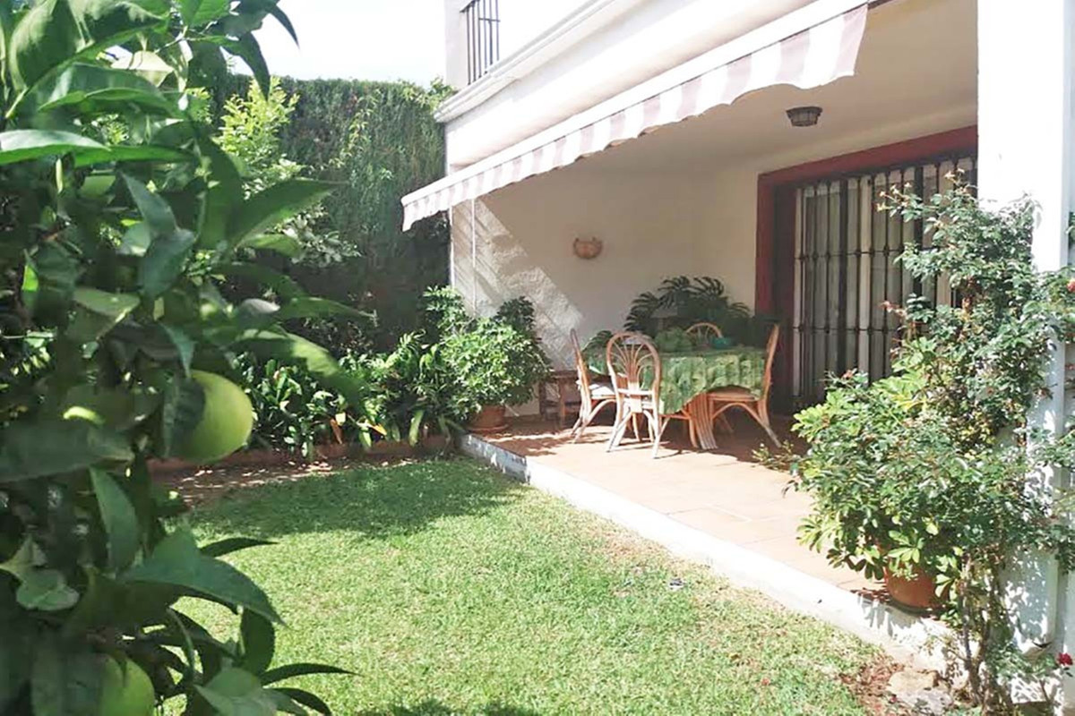Nice semi-detached house all surrounded by a nice garden in a quiet residential area next to shops a, Spain