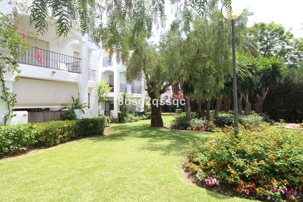 Bargain along Costalita Beach. Garden apartment with 2 bedrooms and 2 bathrooms one of which is en-s, Spain