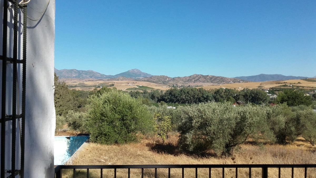 A rustic plot with 29800 m2 in total with a 90 m2 warehouse house, a pool and many olive trees. Righ, Spain