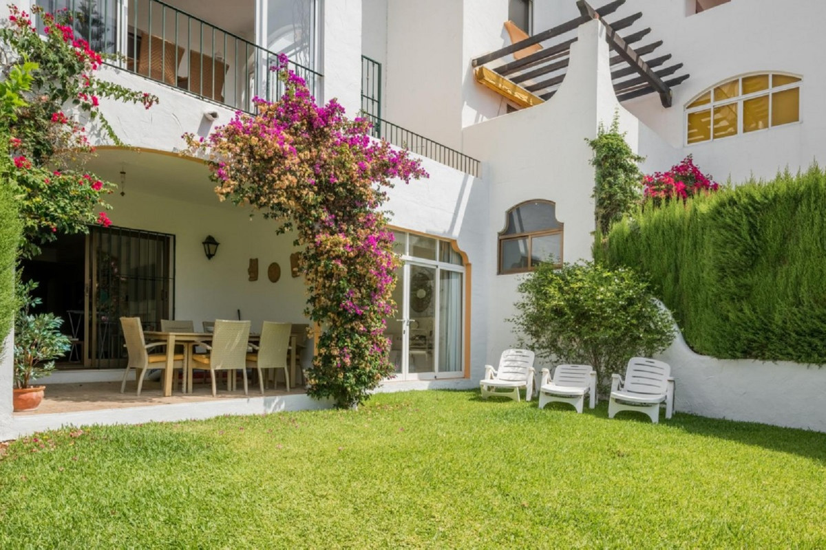 A spacious ground floor apartment with private sunny garden in one of the most sought after communit,Spain