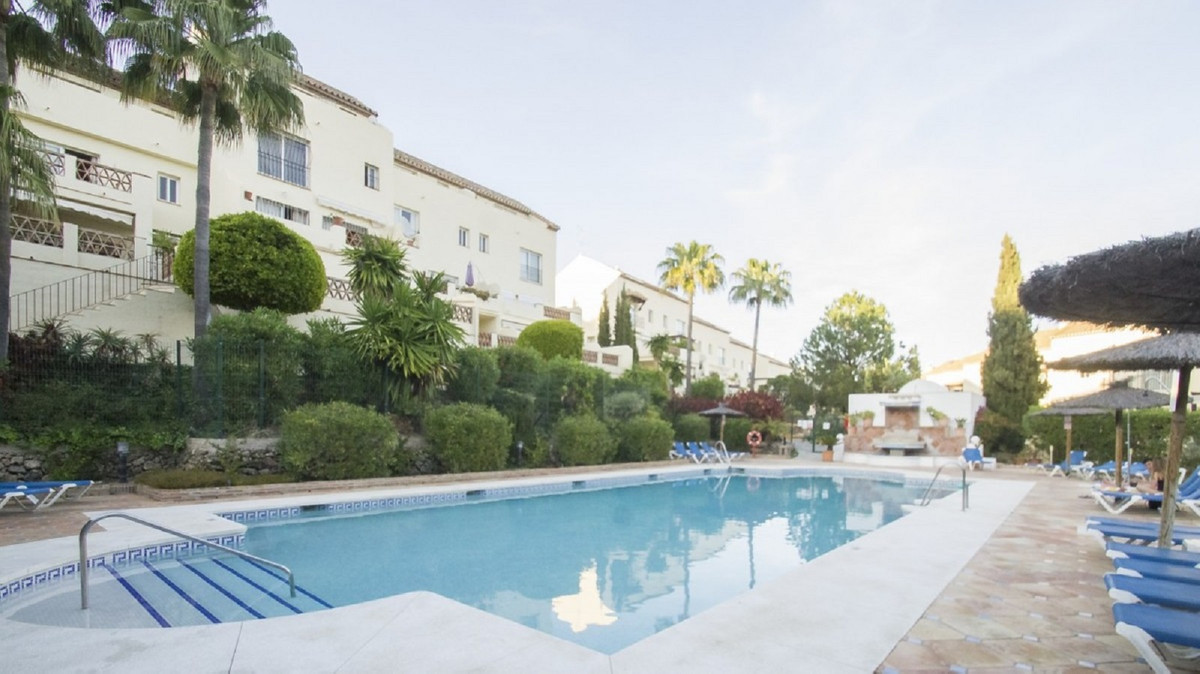 Two bedroom garden apartment which benefits from a good sized welcoming lounge dining area with a mo,Spain