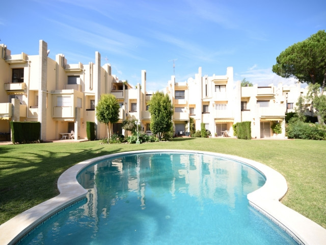 This is a bright and spacious townhouse set in the small, desirable gated community of Miragolf that, Spain