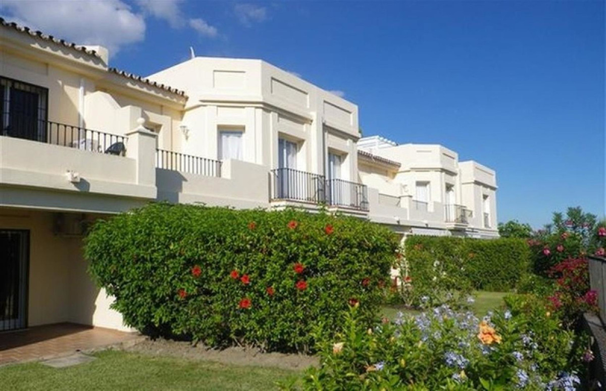 A family sized well presented townhouse in one of the most sought after gated communities close to L, Spain