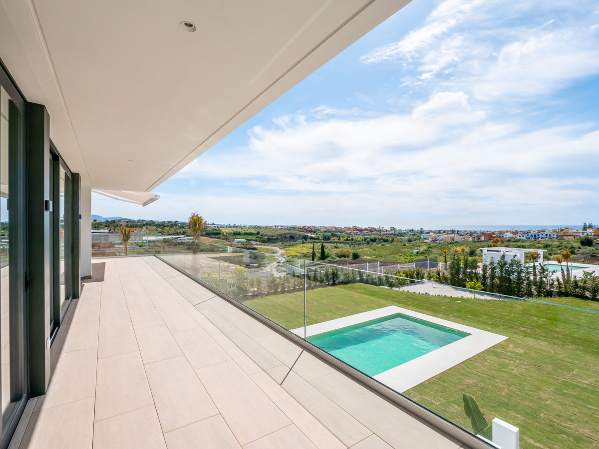Contemporary villa, south facing and with sea views, located in Cancelada, within walking distance t, Spain