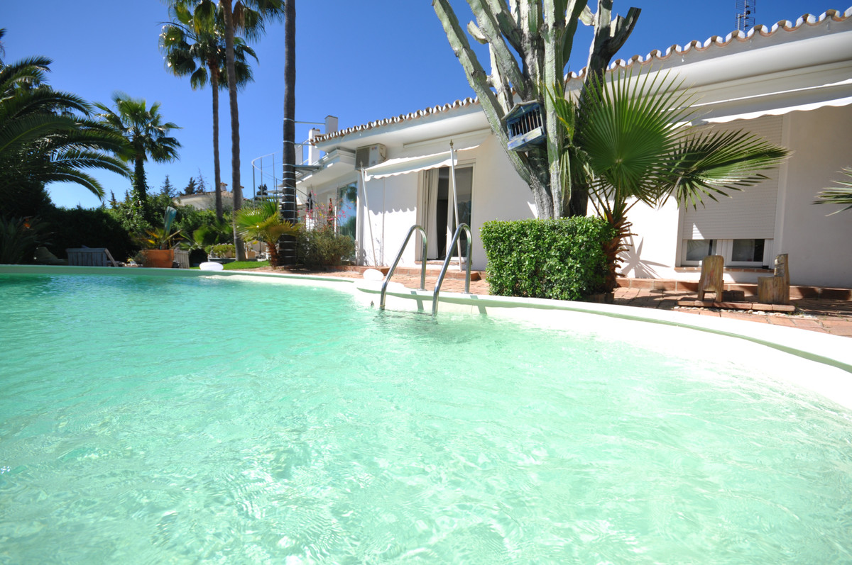 Spacious Andalusian-style family villa in one of Marbella's prime residential areas, next to th, Spain