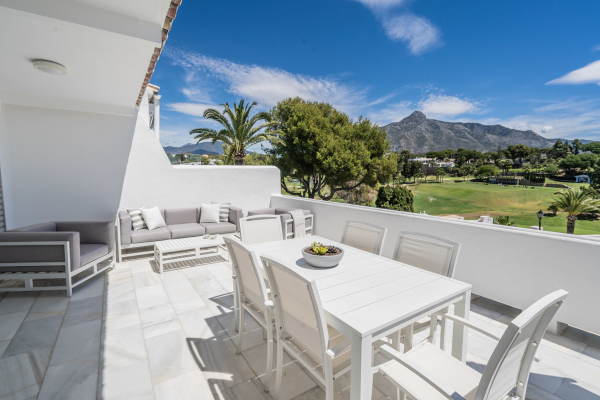 Fantastic townhouse with sea views in popular Azahara, Nueva Andalucia.  The entrance level offers a,Spain