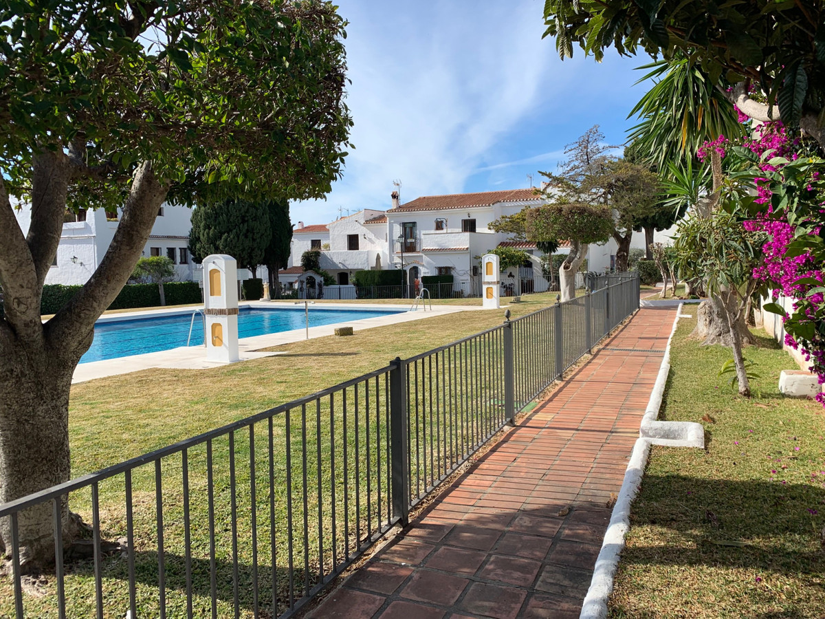 Townhouse in quiet area of Marbella.  Bright townhouse with two bedrooms and a bathroom, with a larg,Spain