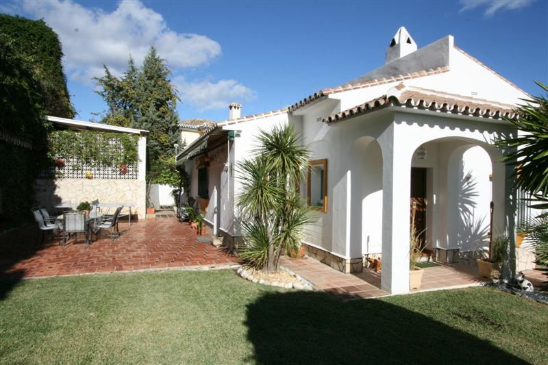 Andalusian style villa with private garden, pool and three garages. The property is situated in the , Spain
