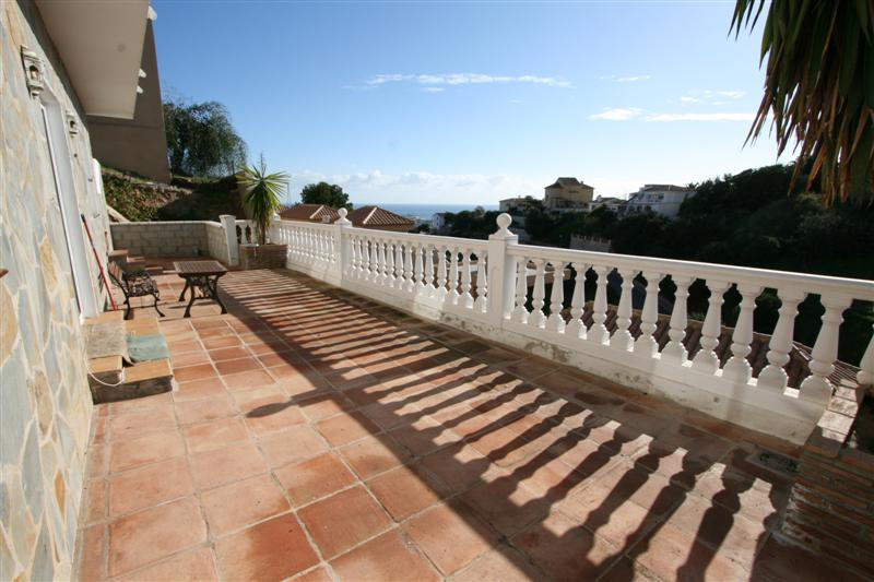 Sunny villa near Fuengirola town with seaviews and a south orientation. This property consists of th,Spain
