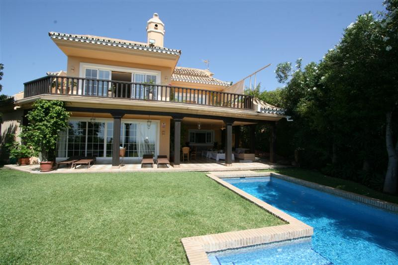 This charming frontline beach and golf villa built on two storeys comes with six bedrooms, six bathr, Spain