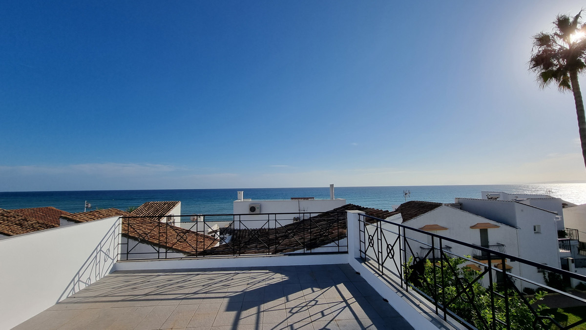 """Fully renovated townhouse located in a beach complex called """"El Pirata"""". The location is f,Spain"""