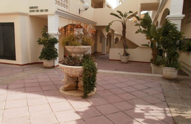 A good sized 2 bed/1 bath apartment in Calahonda which could do with some updating. Situated 5 minut,Spain