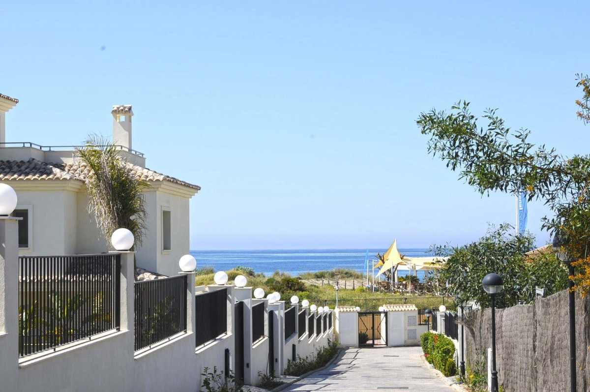 Corner townhouse with garden on the beach front of Marbella East. This property has the best locatio,Spain