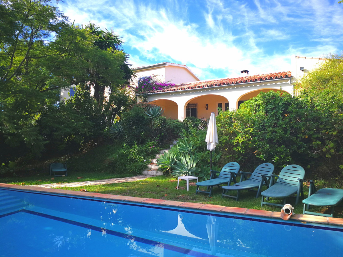 This lovely 'South of France' style rustic house is located on the back side of Estepona wit,Spain