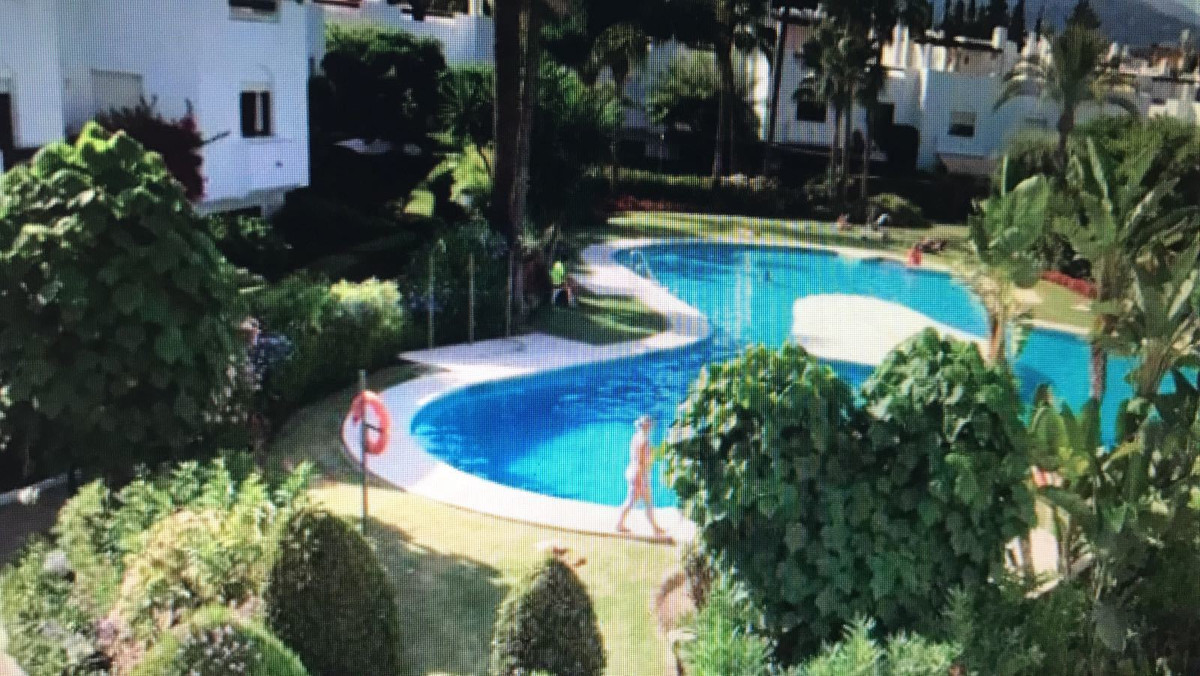 Walk to the beach only 100 metres. Spacious semi-detached house 4 bedrooms. Ideally located gated co,Spain