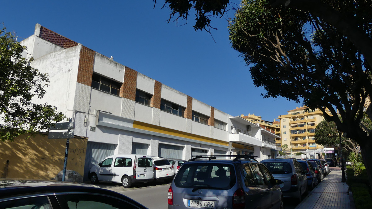 Commercial surface of 38.55 m facade. Old garage for renovation, construction of a new building, hot, Spain