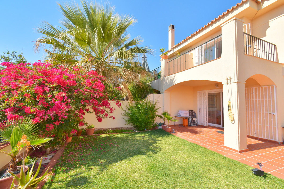 Beautiful semi-detached house with three floors in Mijas Costa. On the ground floor there is a remod,Spain