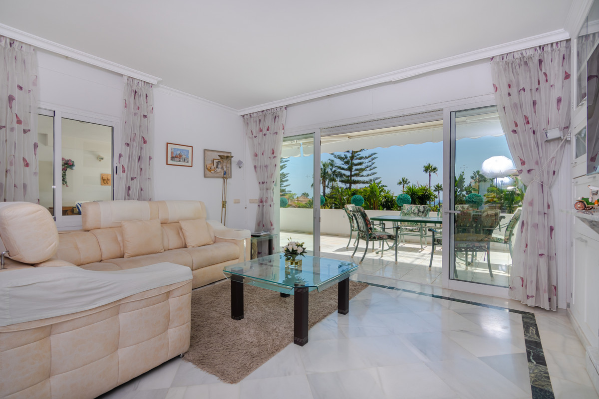 Immaculate South Facing, Front Line Beach elevated ground floor apartment distributed on 2 levels of,Spain