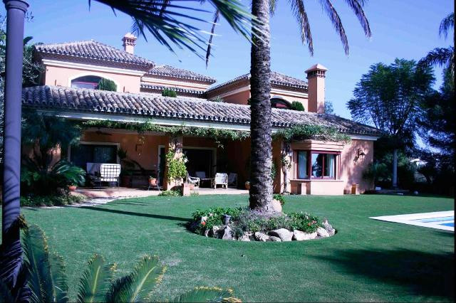 Stunning villa in a plot of 1500m2 situated in Nagueles area in prestigious development with 24h  pr, Spain