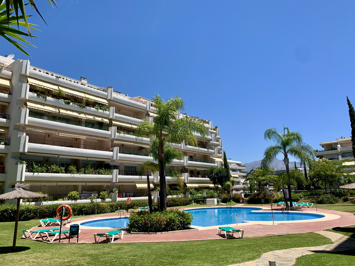 Apartment with golf views in Guadalmina Alta with gardens and community pool. This property on the F, Spain