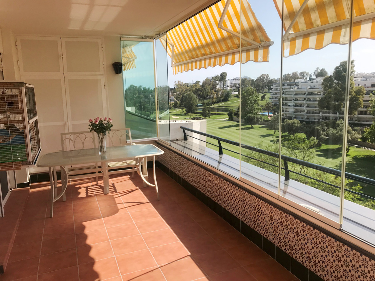 Top floor apartment with golf views in Guadalmina Alta with gardens and community pool. This propert,Spain