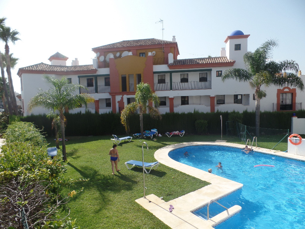 Spacious ground floor apartment in a residential with gardens and pool located in an ideal environme,Spain