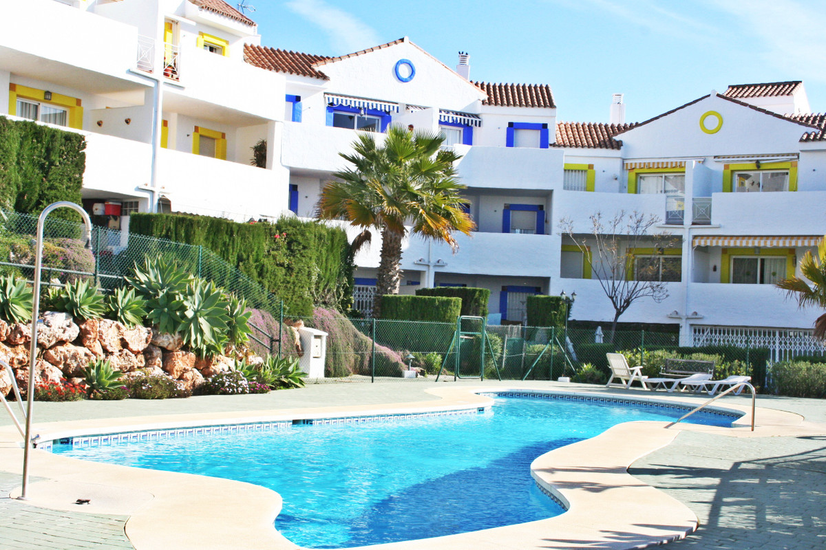 Immaculate ground floor apartment with private patio and  garden with easy access to beautiful commuSpain
