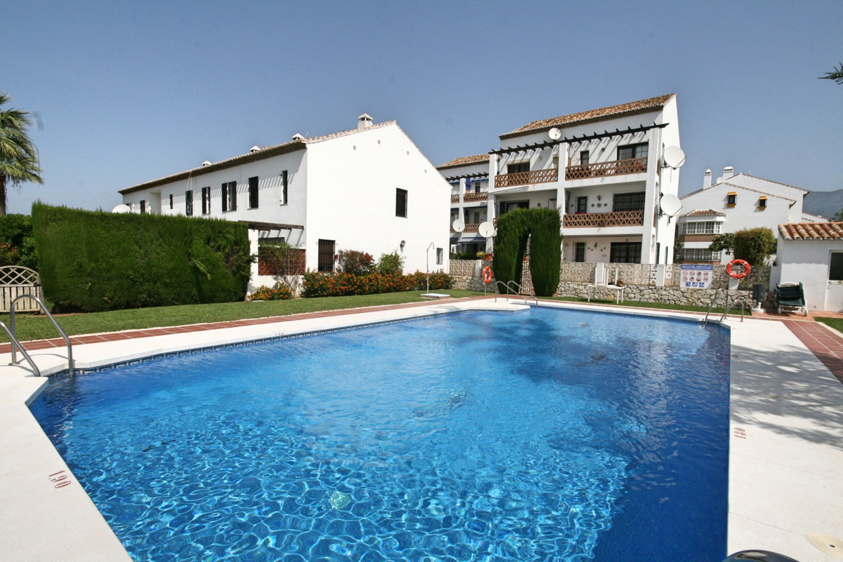 A charming 2 bedroom town house set on a front line golf urbanisation. The property is immaculate an, Spain