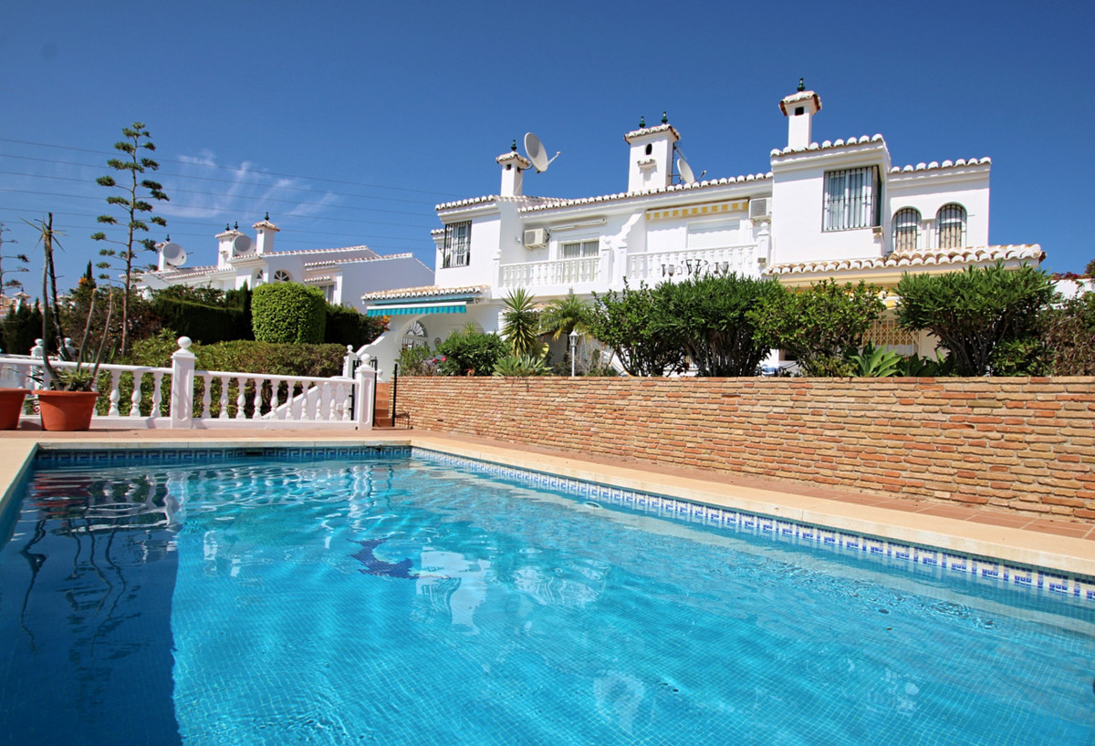 This semi detached villa is wonderfully situated in the upper part of El Chaparral, and has breathta,Spain