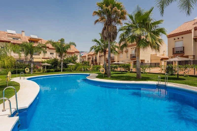 Exceptional semi-detached house in Los Boliches (Fuengirola) consisting of main floor: large living , Spain