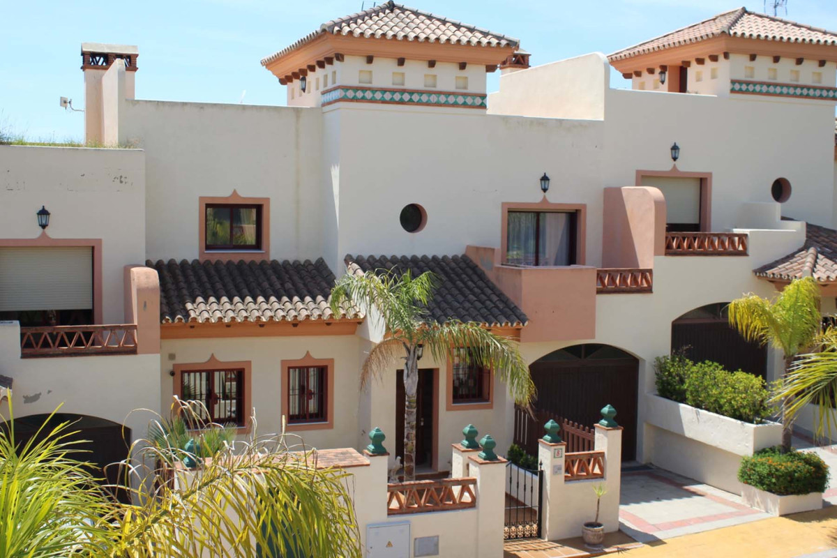 This beautiful 5 bedroom 4 bathroom terraced house comes with a fully fitted apartment with its own ,Spain