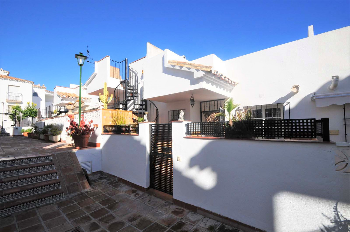 This fantastic 2 bedroom, 2 bathroom townhouse in Benalmadena is only 250 meters from the beach and , Spain