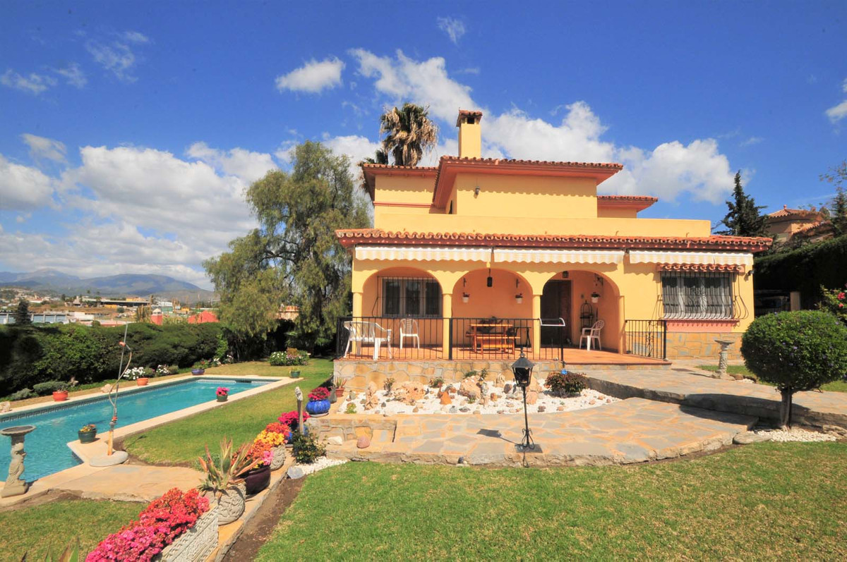 This beautiful detached, Andalucian style villa is located in Alta Vista, within walking distance of, Spain