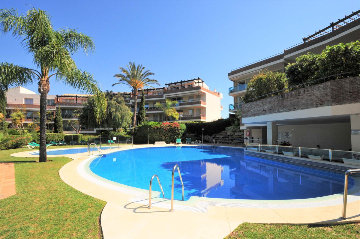 This bright, large 2 bedroom luxury, south east facing elevated ground floor apartment is situated w,Spain