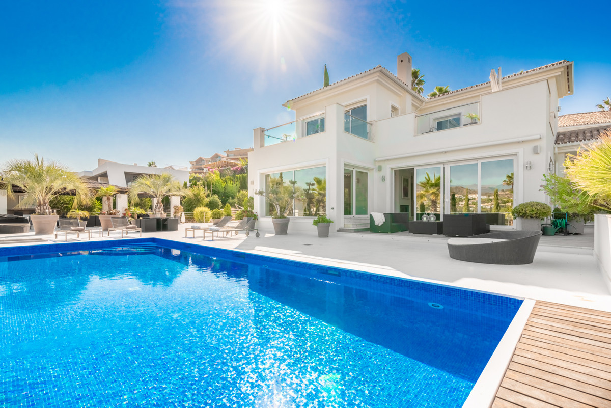 Beautiful modern villa in the heart of the golf valley with commanding views. Entering the property , Spain