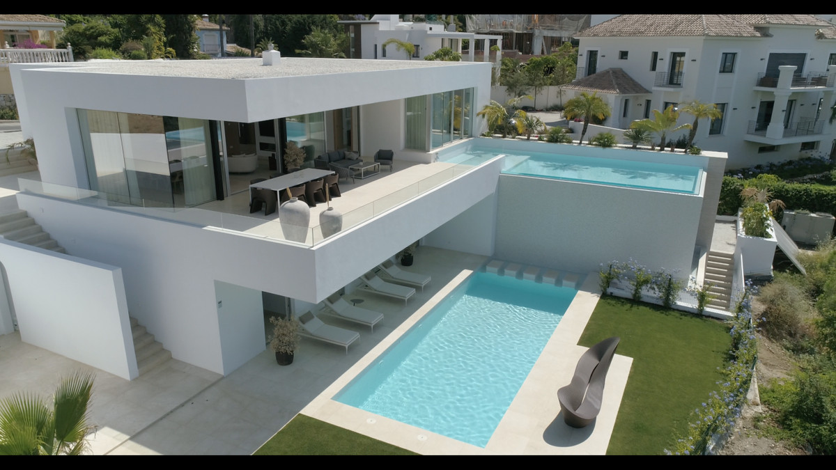 A truly spectacular newly built villa in La Quinta that has it all. Starting on the main level you h,Spain