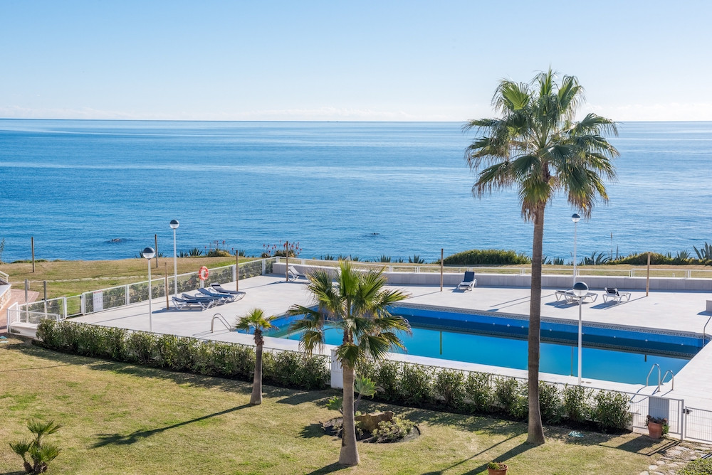 Frontline beach townhouse, walk direct from your lounge and terrace to the beach! Securely gated com,Spain