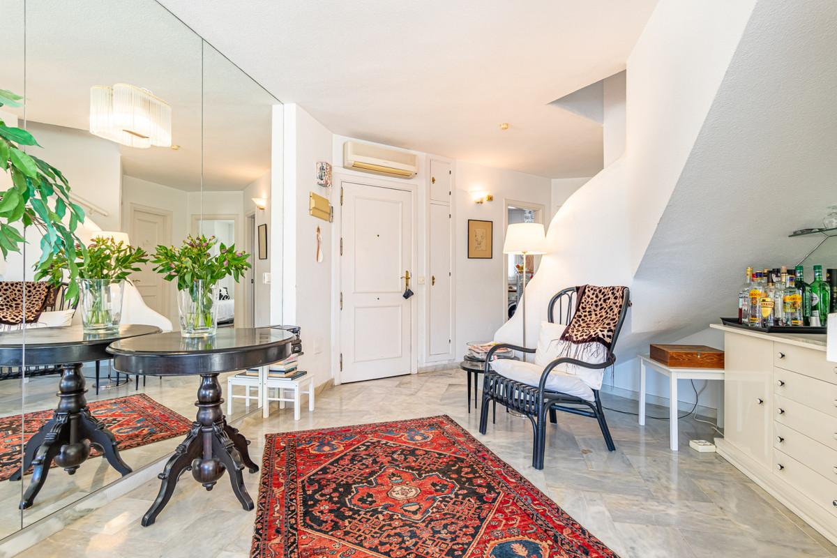 Bright duplex apartment in the prestigious Benalgolf condominium. Quiet and good location close to a,Spain